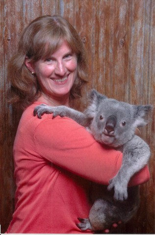 Pollygone Travel - Polly Pyle in Australia (with a Koala Bear).